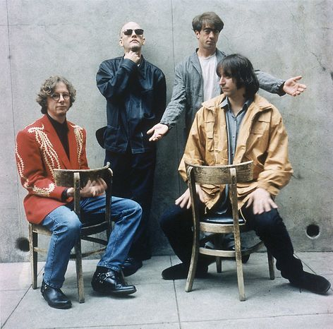 """** FILE ** In this 1994 file photo originally released by Warner Bros. Records, alternative rock band R.E.M., from left, Mike Mills, Michael Stipe, Bill Berry, and Peter Buck are shown when they released their new album """"Monster."""" The band announced Wednesday, Sept. 21, 2011, on their website that they are breaking up. (AP Photo/Warner Bros.)"""