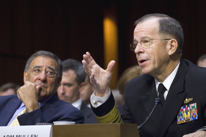 Defense Secretary Leon E. Panetta (left) looks on as Adm. Mike Mullen, chairman of the Joint Chiefs of Staff, testifies on Capitol Hill in Washington on Thursday, Sept. 22, 2011, before the Senate Armed Services Committee on U.S. strategy in Afghanistan and Iraq. (AP Photo/Harry Hamburg)