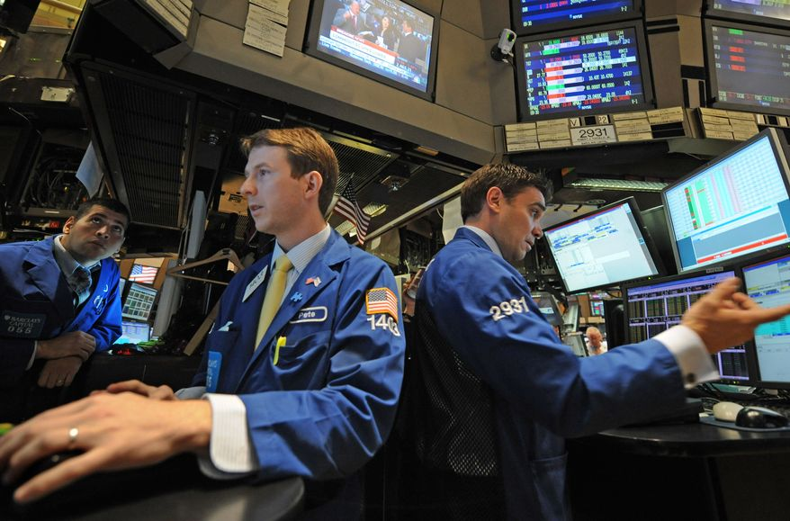 Traders work on the floor of the New York Stock Exchange on Thursday, Sept. 22, 2011, in New York. Stocks were sharply lower worldwide over indications that the global economy is in for a long slump. (AP Photo/Louis Lanzano)