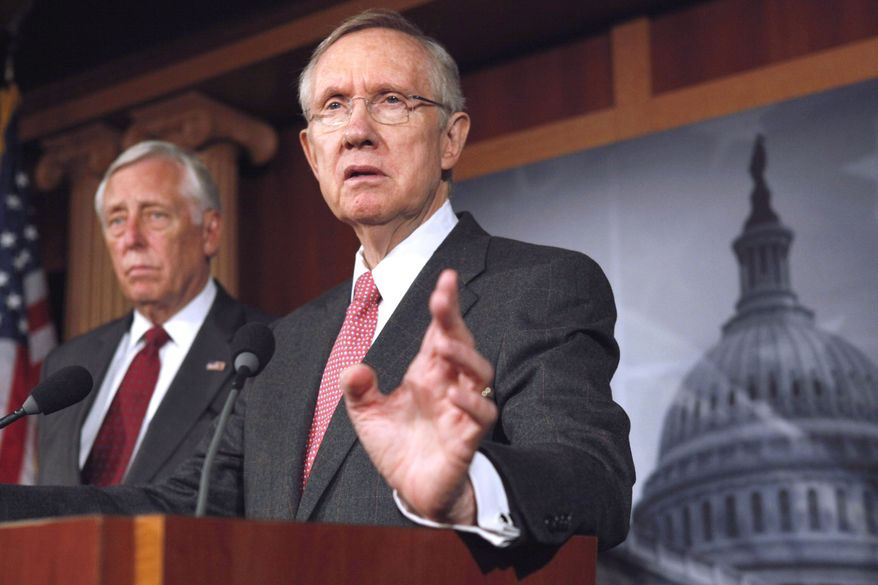Senate Majority Leader Harry Reid (right), Nevada Democrat, accompanied by House Minority Whip Steny Hoyer, Maryland Democrat, speaks Sept. 23, 2011, during a news conference on Capitol Hill to discuss the continuing resolution to keep the government open. (Associated Press)