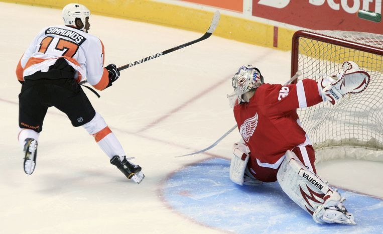 Philadelphia Flyers' Wayne Simmonds scores on Detroit Red Wings goalie Jordan Pearce during the shootout of a preseason NHL hockey game in London, Ontario, Thursday, Sept. 22, 2011. (AP Photo/The Canadian Press, Dave Chidley)