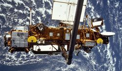 ** FILE ** In this file image provided by NASA, this is the STS-48 onboard photo of the Upper Atmosphere Research Satellite (UARS) in the grasp of the RMS (Remote Manipulator System) during deployment, from the shuttle in September 1991. (AP Photo/NASA)