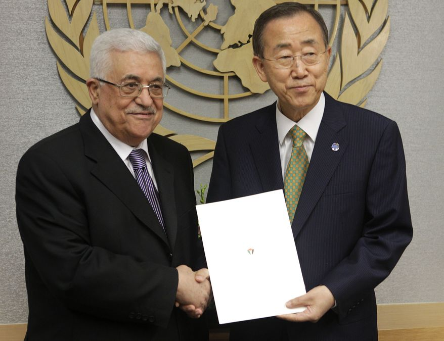 Palestinian President Mahmoud Abbas (left) poses for a picture with Secretary-General Ban Ki-moon after giving him a letter requesting recognition of Palestine as a state during the 66th session of the General Assembly at United Nations headquarters on Sept. 23, 2011. (Associated Press)