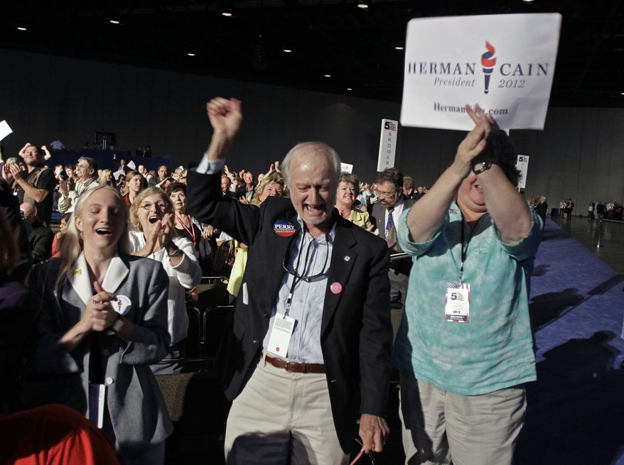 Republican delegates cheer after the results of a straw poll with Republican candidate businessman Herman Cain the clear winner with 37 percent of the vote during a Florida Republican Party Presidency 5 Convention Saturday, Sept. 24, 2011, in Orlando, Fla. (AP Photo/John Raoux)