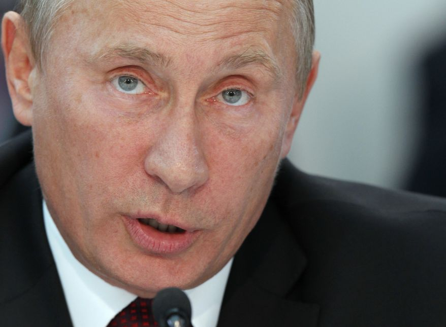 Russian Prime Minister Vladimir Putin attends a United Russia party's congress in Moscow on Friday, Sept. 23, 2011. (AP Photo/Ivan Sekretarev)