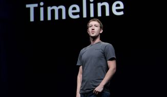 "Facebook chief Mark Zuckerberg talks about Timeline at a developers conference Sept. 22 in San Francisco. Users can share their choices of music, movies, games and news sources with their friends as part of what the Facebook website describes as a new way to ""tell your life story with a new kind of profile."" (Associated Press)"