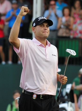 Bill Haas celebrates winning the FedEx Cup and the Tour Championship golf tournament on the third playoff hole over Hunter Mahan on Sunday at East Lake Golf Club in Atlanta. (Associated Press)