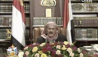 Yemeni President Ali Abdullah Saleh speaks on state television on Sunday. The embattled president says he endorses a U.S.-backed power-transfer deal, however he remained defiant in the face of protesters. (Associated Press)