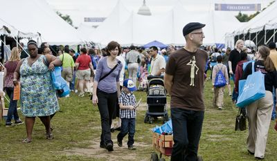 Kelly Caldwell, center, of Washington, D.C., walks with her son Fionn, 4, behind her husband Chris through the National Book Festival on the National Mall in Washington, D.C. on Sept. 25, 2011.