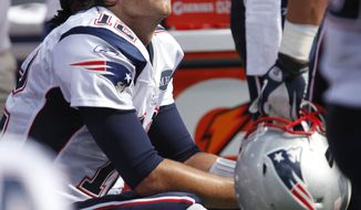 New England Patriots quarterback Tom Brady sits on the bench after throwing an interception during the first half of an NFL football game in Orchard Park, N.Y., Sunday, Sept. 25, 2011. (AP Photo/Derek Gee)