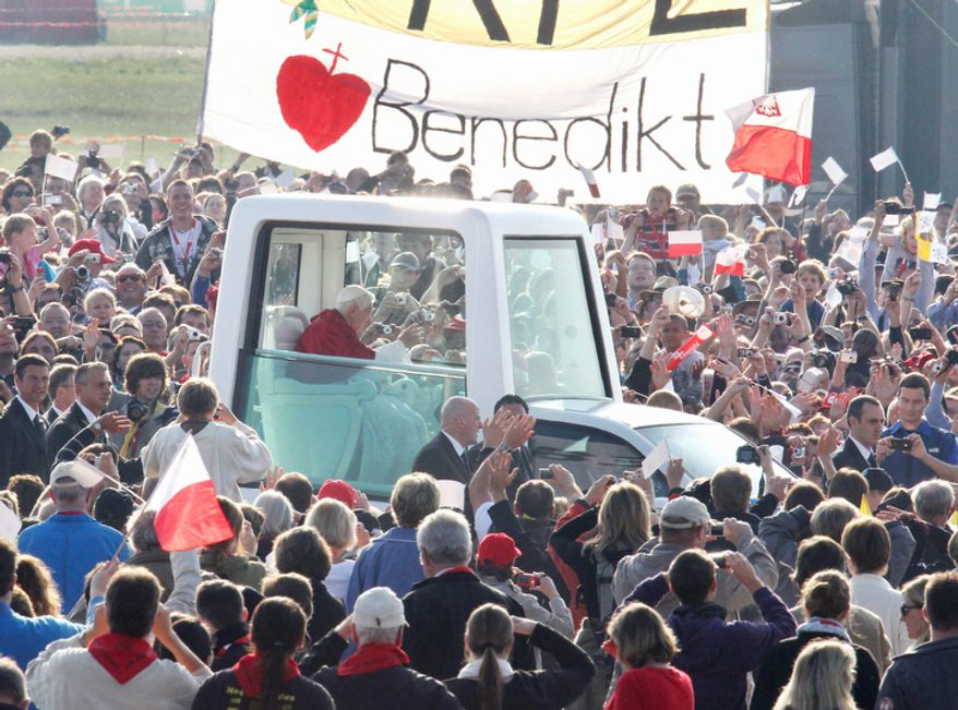 The popemobile with Pope Benedict XVI drives through the crowd prior to a service in Freiburg, Germany.(AP Photo/Michael Probst)
