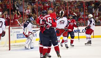 Washington Capitals' Cody Eakin (50) and Chris Bourque (56) celebrate Eakin's goal on Columbus Blue Jackets' Curtis Sanford (30) in the first period at Verizon Center on Monday, Sept. 26, 2011. The Caps won the preseason game 3-1. (Andrew Harnik / The Washington Times)