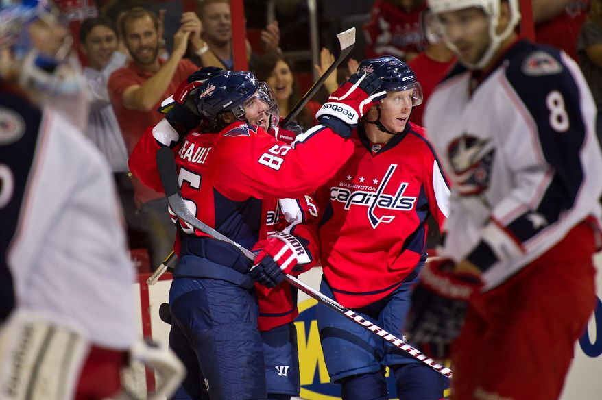 Washington Capitals' Mathieu Perreault (85) celebrates with his teammates after scoring in the second period against the Columbus Blue Jackets in a preseason hockey game at the Verizon Center in D.C., on September 26, 2011. (Andrew Harnik/The Washington Times)