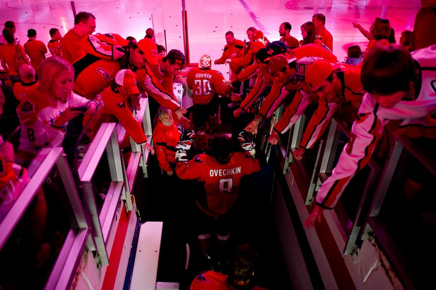 Alex Ovechkin (8) of the Washington Capitals gets welcomed as he comes out for warm ups before preseason hockey at the Verizon Center in Washington, DC, Monday, September 26, 2011. (Andrew Harnik / The Washington Times)