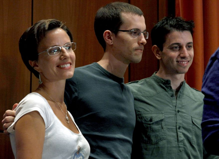** FILE ** Sarah Shourd (left), Shane Bauer (center) and Josh Fattal stand together after a news conference in New York on Sept. 25, 2011. Fattal and Bauer, both 29, were held for more than two years in an Iranian prison before being freed last week under a $1 million bail deal. Fellow hiker Shourd was released from the prison last year. (Associated Press)