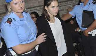 Authorities escort Amanda Knox (center) to court in Perugia, Italy, on Monday, Sept. 26, 2011. (AP Photo/Stefano Medici)