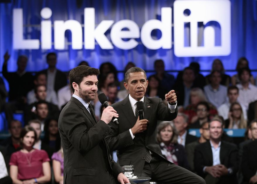 President Obama, accompanied by LinkedIn CEO Jeff Weiner, gestures Sept. 26, 2011, during a LinkedIn town hall at the Computer History Museum in Mountain View, Calif. (Associated Press)