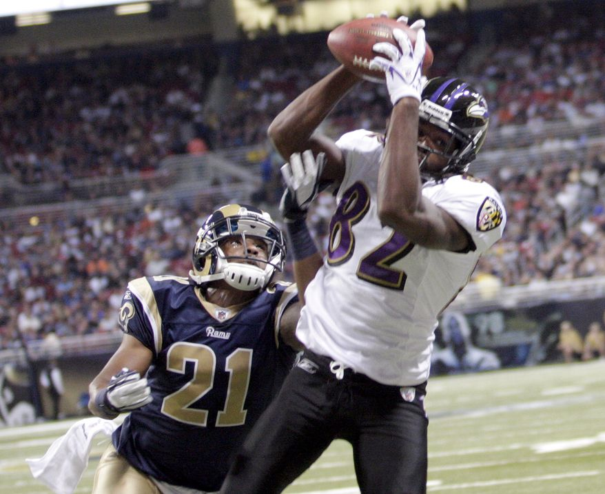 Baltimore Ravens wide receiver Torrey Smith, right, catches an 18-yard touchdown pass as St. Louis Rams cornerback Justin King defends during the first quarter of an NFL football game Sunday, Sept. 25, 2011, in St. Louis. (AP Photo/Tom Gannam)