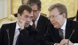 ** FILE ** Russian President Dmitry Medvedev (left) and Finance Minister Alexei Kudrin attend a meeting of the Eurasian Economic Community Interstate Council in Moscow in December 2010. (AP Photo/RIA Novosti, Dmitry Astakhov, Presidential Press Service, File)