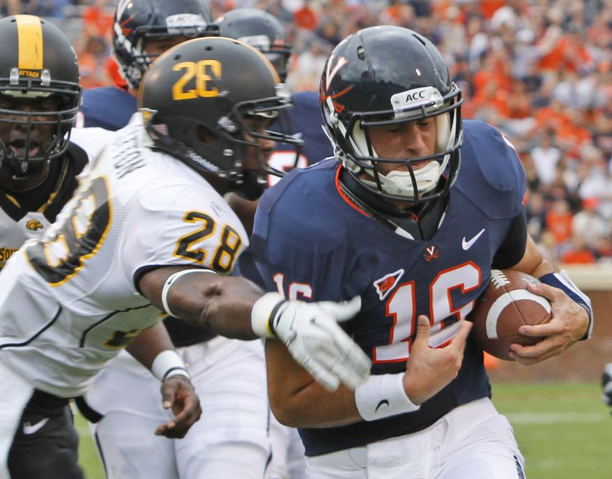 Virginia quarterback Michael Rocco took a shot to the ribs in the game against Southern Mississippi on Saturday and his status for the Cavaliers' next game against Idaho is unclear. (AP Photo/Steve Helber)