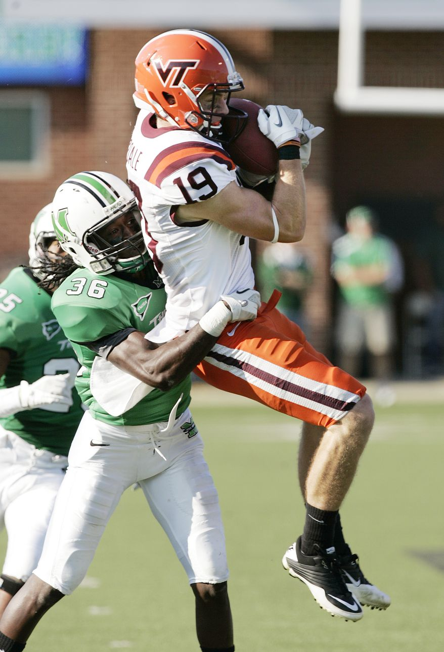 Marshall defensive back Monterius Lovett, left, grabs Virginia Tech's Danny Coale, who makes a catch during the first half of an NCAA football game Saturday, Sept. 24, 2011, in Huntington, W.Va. (AP Photo/Randy Snyder)