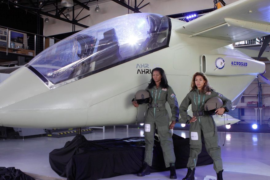 A life-size model of an Advanced High Performance Reconnaissance Light Aircraft plane is unveiled at a ceremony in Pretoria, South Africa, on Tuesday. The aircraft is the first all-African military plane that can be used for peacekeeping missions and reconnaissance work and is armed to defend itself. (Associated Press)