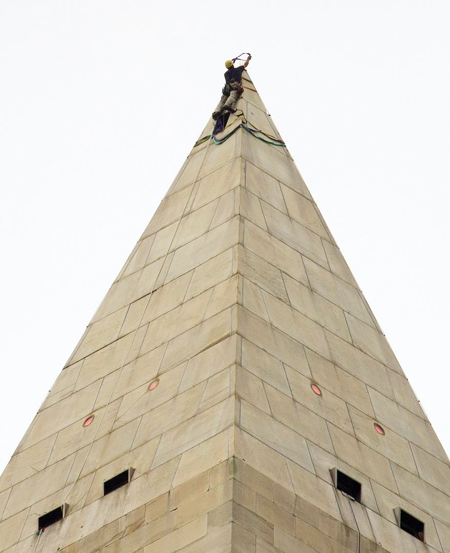 "Dave Megerle, a member of the Wiss, Janney, Elstner Associates ""difficult-access team,"" prepares rappelling gear atop the Washington Monument on Tuesday. (Rod Lamkey Jr./The Washington Times)"