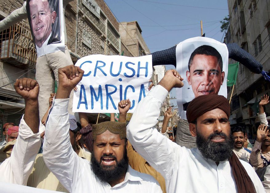 FOES OF AMERICA: Supporters of Sunni Tehreek, a Pakistani religious party, rally against the U.S. in Hyderabad on Tuesday. Pakistan lashed out at the U.S. for accusing the country's intelligence agency of supporting extremist attacks. (Associated Press)