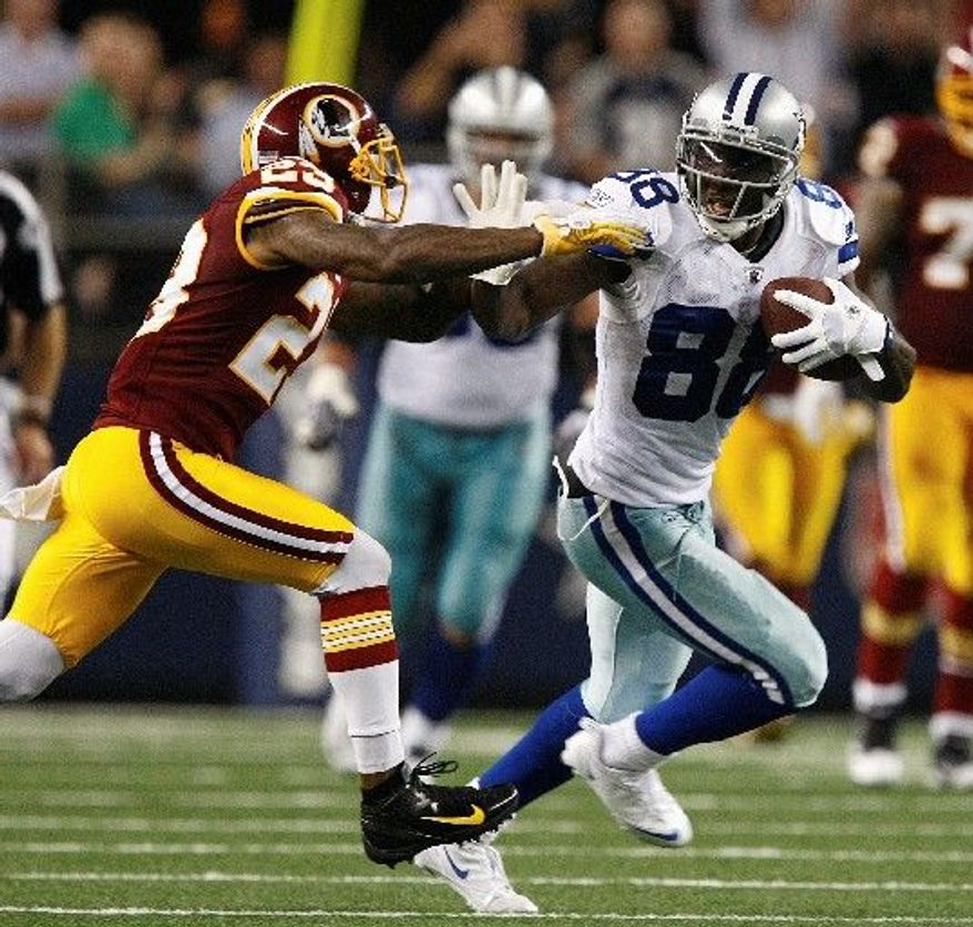 Dallas Cowboys wide receiver Dez Bryant (88) runs with pressure from Washington Redskins cornerback DeAngelo Hall (23) during the second half of an NFL football game Monday, Sept. 26, 2011, in Arlington, Texas. (AP Photo/Waco Tribune Herald, Jose Yau)