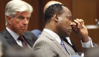 Conrad Murray wipes a tear during the defense's opening arguments in his involuntary manslaughter trial at Superior Court on Sept. 27, 2011 in Los Angeles. Murray has pleaded not guilty and faces four years in prison and the loss of his medical license if convicted of involuntary manslaughter in Michael Jackson's death. (Associated Press)