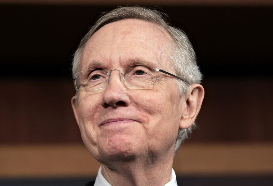 Senate Majority Leader Harry Reid, Nevada Democrat, smiles after talking about the short-term funding bill that the Senate passed on Monday, Sept. 26, 2011. (AP Photo/J. Scott Applewhite)