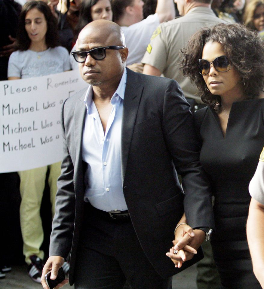 Randy Jackson and Janet Jackson arrive as the involuntary manslaughter trial for Dr. Conrad Murray, Michael Jackson's personal physician when the pop star died, gets underway at the Criminal Justice Center. (Associated Press)