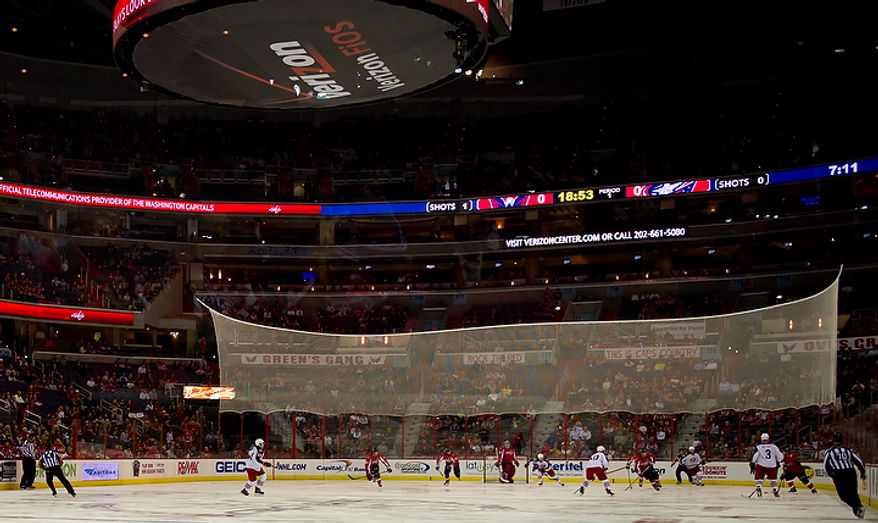 Some Washington Capitals hockey fans are complaining that they are having trouble seeing through the new white protective net around the hockey rink seen here during monday nights game against the Columbus Blue Jackets in preseason hockey at the Verizon Center in Washington, DC, September 26, 2011. (Andrew Harnik / The Washington Times)