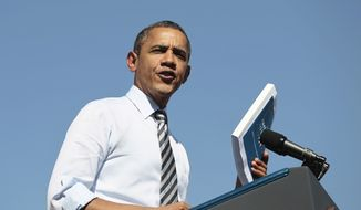 President Obama holds ups his proposed American Jobs Act legislation while speaking at Abraham Lincoln High School in Denver on Sept. 27, 2011. (Associated Press)