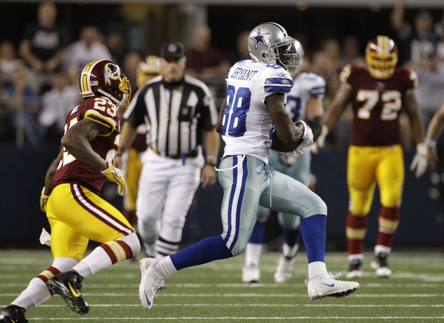 Washington Redskins cornerback DeAngelo Hall gives chase to Dallas Cowboys wide receiver Dez Bryant  following Bryant's reception at the end of the fourth quarter in Arlington, Texas. The Cowboys won 18-16. (AP Photo/Tony Gutierrez)