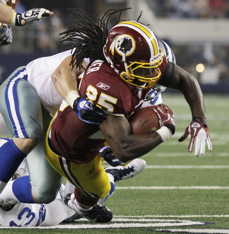 Dallas Cowboys linebacker Sean Lee tackles Washington Redskins running back Tim Hightower during the second half of an NFL football game Monday, Sept. 26, 2011, in Arlington, Texas. (AP Photo/Tony Gutierrez)