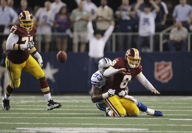 Dallas Cowboys outside linebacker Anthony Spencer causes Washington Redskins quarterback Rex Grossman to fumble near the end of the fourth quarter in Dallas' 18-16 win. (AP Photo/Tony Gutierrez)