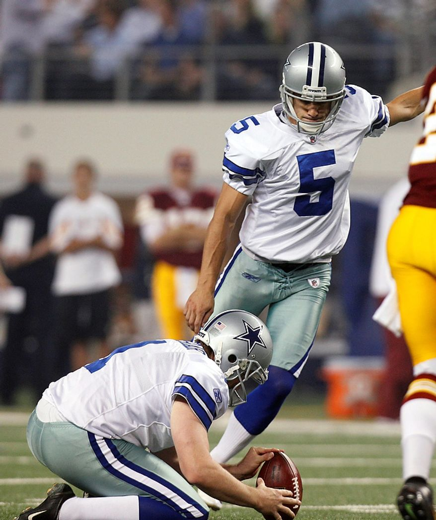 Dallas Cowboys punter Mat McBriar holds as Dan Bailey kicks a field goal against the Washington Redskins during the first half of an NFL football game Monday, Sept. 26, 2011, in Arlington, Texas. (AP Photo/LM Otero)