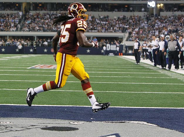 Washington Redskins running back Tim Hightower scores a touchdown against the Dallas Cowboys during the second half of an NFL football game Monday, Sept. 26, 2011, in Arlington, Texas. (AP Photo/LM