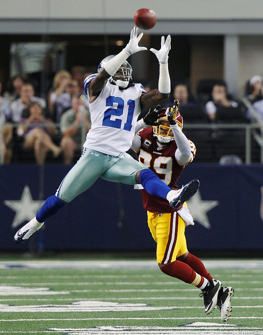 Dallas Cowboys cornerback Mike Jenkins goes up to knock away a pass to Washington Redskins wide receiver Santana Moss during the second half of an NFL football game Monday, Sept. 26, 2011, in Arlington, Texas. The pass was incomplete. (AP Photo/LM Otero)