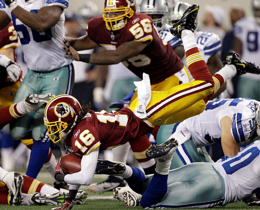 Washington Redskins wide receiver Brandon Banks (16) goes down while carrying the ball against the Dallas Cowboys during the second half of an NFL football game Monday, Sept. 26, 2011, in Arlington, Texas. The Cowboys won 18-16. (AP Photo/Tony Gutierrez)
