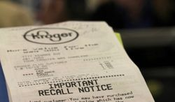 ** FILE ** In this June 27, 2011, photo, a Kroger store receipt with a food recall notice on it sits near a check out lane at a Cincinnati Kroger. Tyson Fresh Meats Inc. is recalling about 131,300 pounds of ground beef that might be contaminated with E. coli, the U.S. Department of Agriculture reported Wednesday, Sept. 28, 2011. (AP Photo/Tom Uhlman)