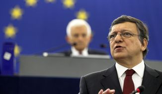 Jose Manuel Barroso (foreground), president of the executive European Commission, speaks to the European Parliament in Strasbourg, France, on Wednesday, Sept. 28, 2011. (AP Photo)