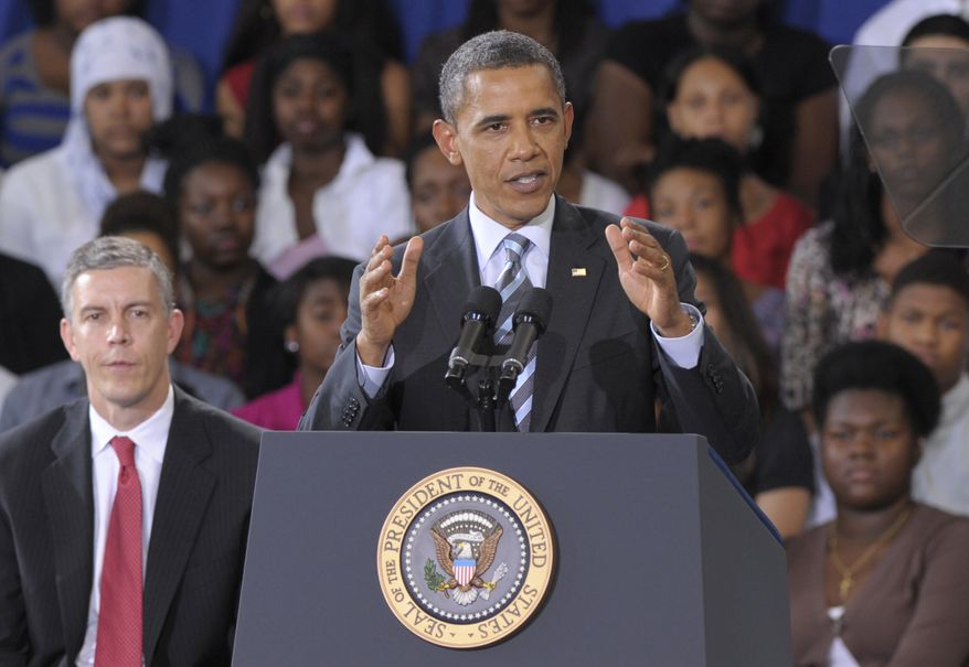 President Obama, accompanied by Education Secretary Arne Duncan (left), delivers his back-to school speech on Sept. 28, 2011, at Benjamin Banneker Academic High School in D.C. (Associated Press)