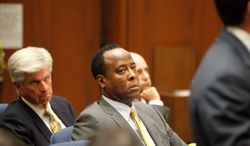 Conrad Murray listens to testimony from witness Faheem Muhammad on the second day of his involuntary manslaughter trial in the death of pop star Michael Jackson in downtown Los Angeles, Wednesday, Sept. 28, 2011. Murray has pleaded not guilty and faces four years in prison and the loss of his medical license if convicted of involuntary manslaughter. (AP Photo/Al Seib, Pool)