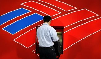 Bank of America plans to start charging customers a $5 monthly fee for debit cards as a way to make up for losses related to the cap on swipe fees that goes into effect Saturday. (Associated Press)