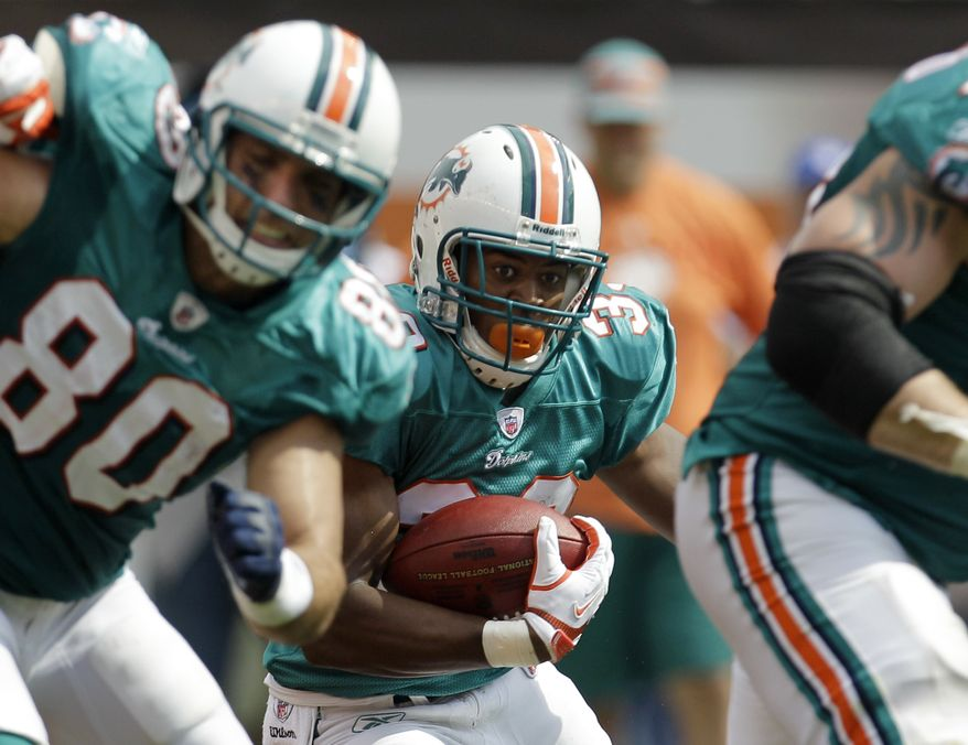 Miami Dolphins running back Daniel Thomas looks for a seam on a second quarter run against the Cleveland Browns in an NFL football game Sunday, Sept. 25, 2011, in Cleveland. (AP Photo/Tony Dejak)