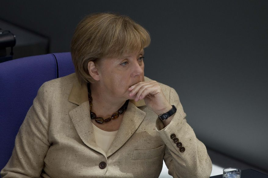 German Chancellor Angela Merkel listens to the debate on the eurozone bailout fund in the Bundestag, the lower legislative house, at the Reichstag in Berlin on Thursday, Sept. 29, 2011. (AP Photo/Markus Schreiber)