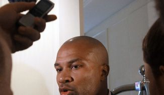 """This June 21, 2011 file photo shows Los Angeles Lakers basketball player and players association president Derek Fisher speaking to reporters, in New York. NBA owners and players will meet Friday, Sept. 30, 2011, and perhaps through the weekend, with Commissioner David Stern warning there are """"enormous consequences at play"""" as the sides try to preserve an on-time start to the season. (AP Photo/Bebeto Matthews, File)"""