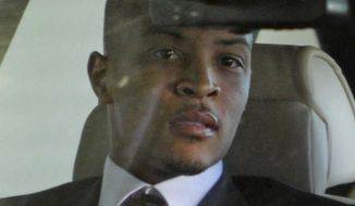 **FILE** Rapper T.I., whose real name is Clifford Harris Jr., leaves Federal Court on Oct. 15, 2010, after being sentenced to 11 months in prison for a probation violation, in Atlanta. (Associated Press)